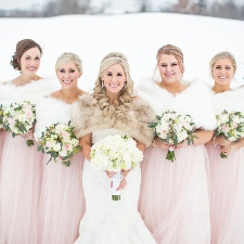 Bride and bridesmaids at a winter wedding reception at Hazeltine National Golf Club