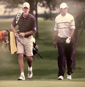 Jim Arnold with Tiger Woods