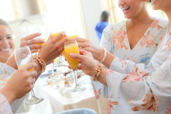 Bridesmaids toasting bride in Bridal Suite at Hazeltine National Golf Club