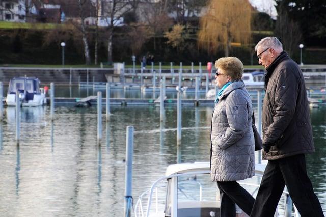 senior couple strolling at marina