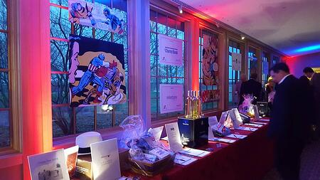 Silent auction of a charity fundraising gala at Hazeltine National Golf Club