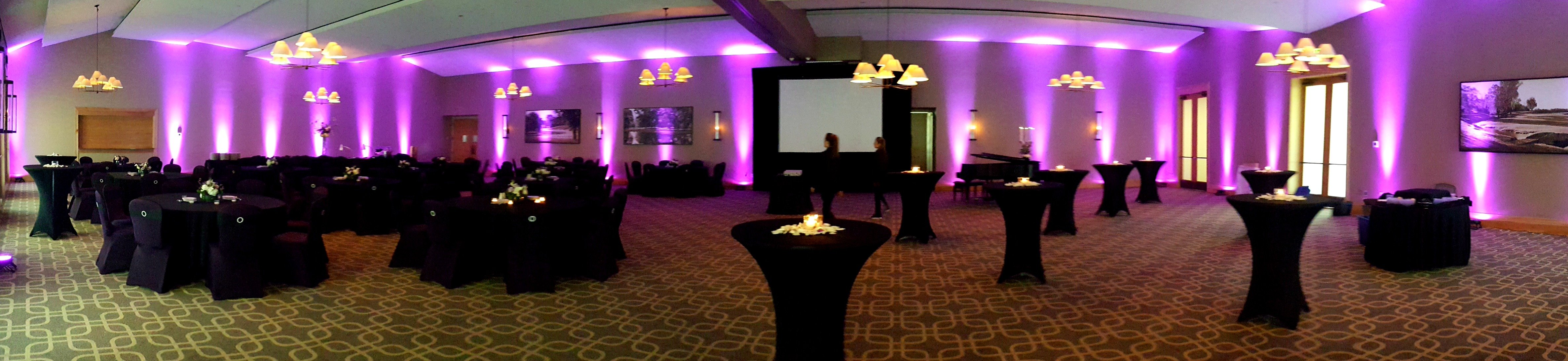 Dramatic purple uplighting set the mood in the ballroom at Hazeltine National Golf Club for a fundraising gala