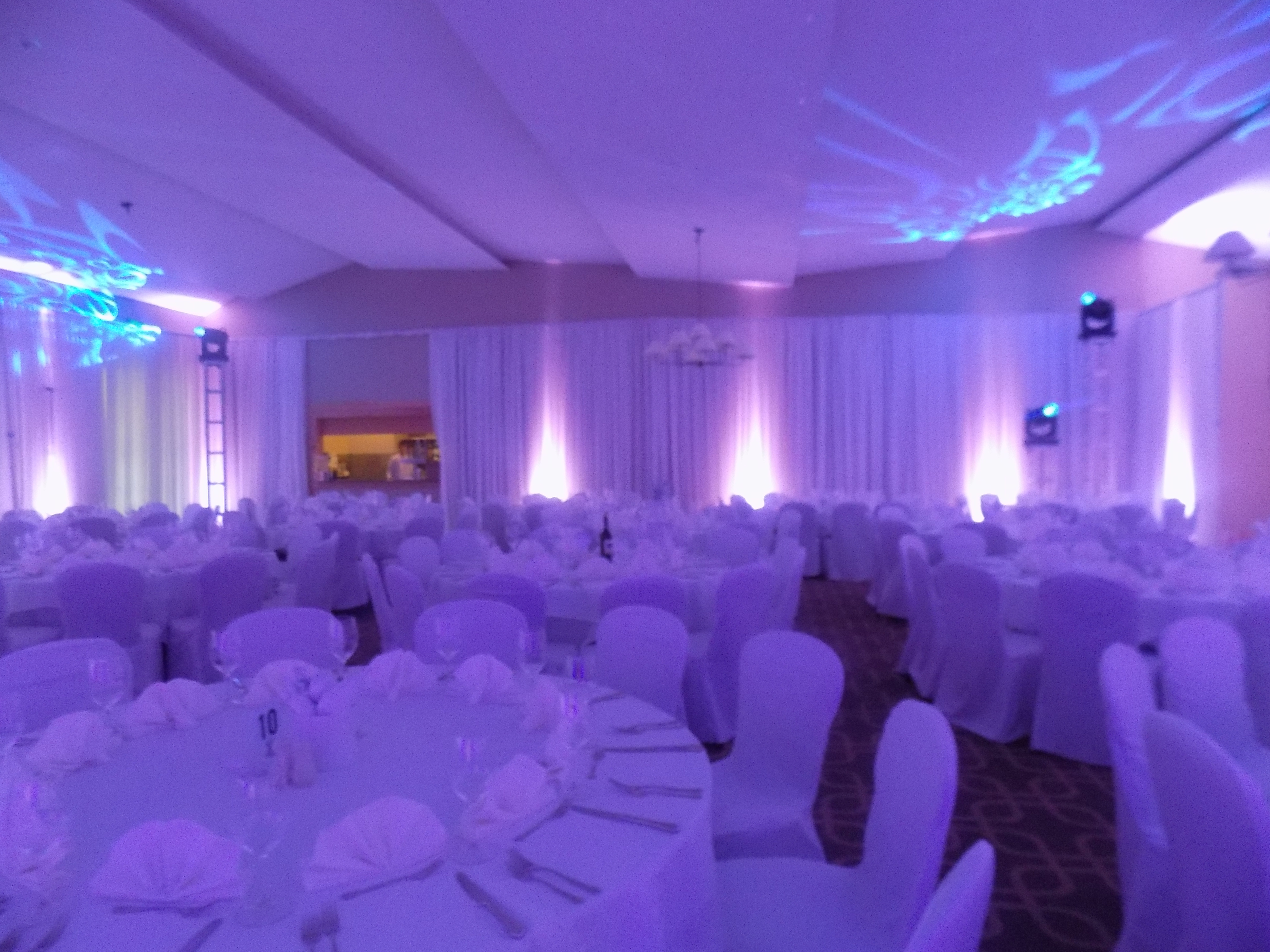 Dramatic Uplighting and decor set the mood for a fundraising gala at Hazelitne National Golf Club