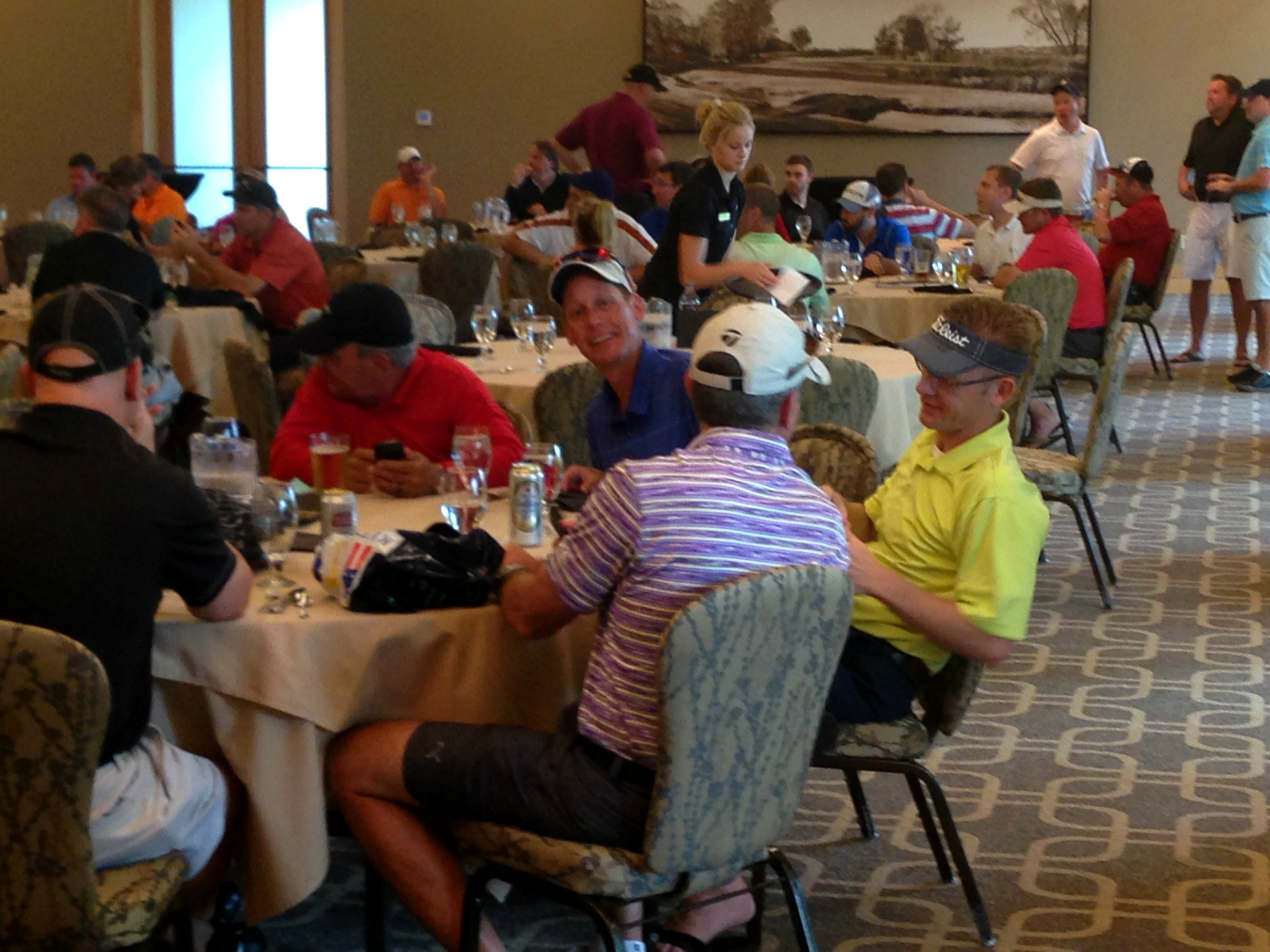 Golfers enjoy dinner after competing in a private golf tournament at Hazelitne National Golf Club
