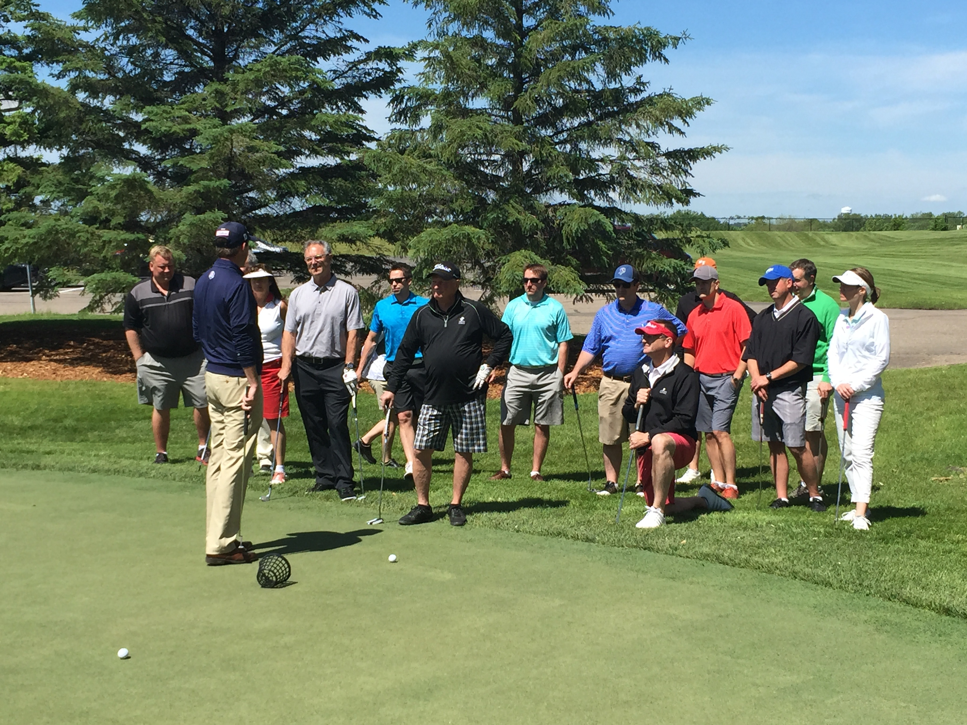Golfers participating in a Short Game Clinic at a private golf tournament at Hazeltine National Golf Club