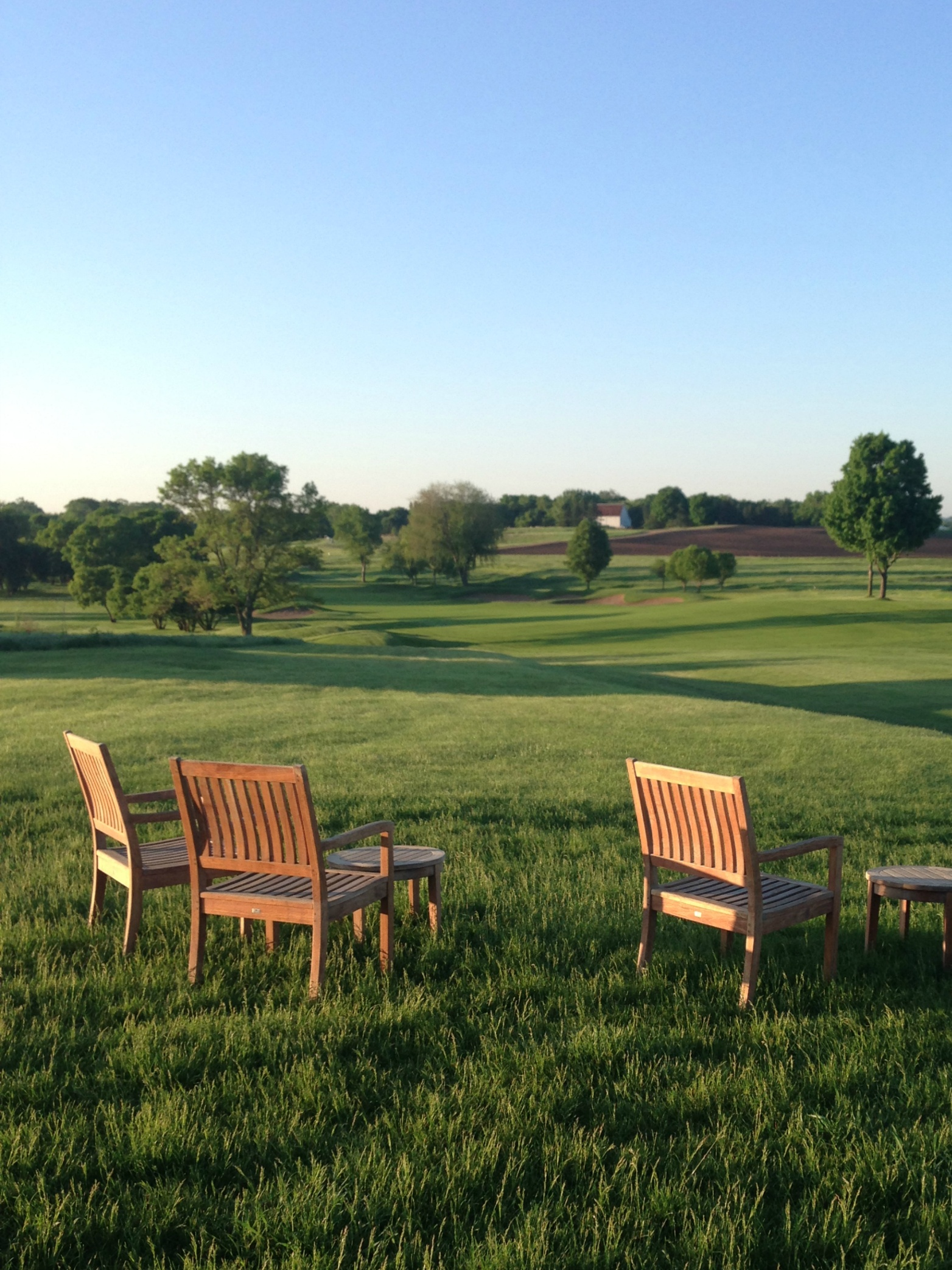 Quiet moment overlooking the first tee before the start of a private golf tournament at Hazeltine National Golf Club