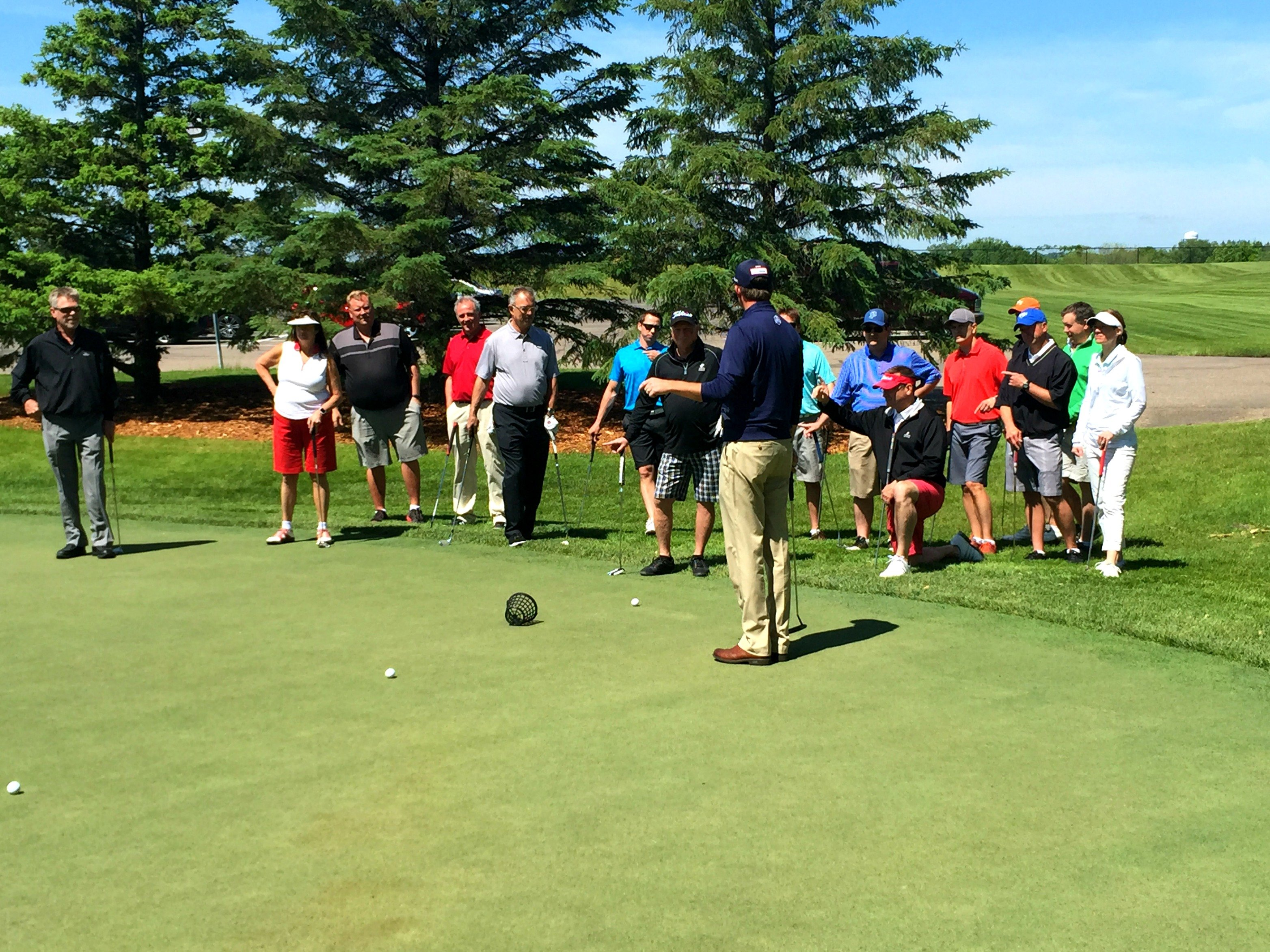 Business golfers at a golf clinic and social event at Hazeltine National Golf Club