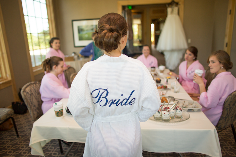 Bride and bridesmaids in the bridal suite before the wedding reception at Hazeltine National Golf Club