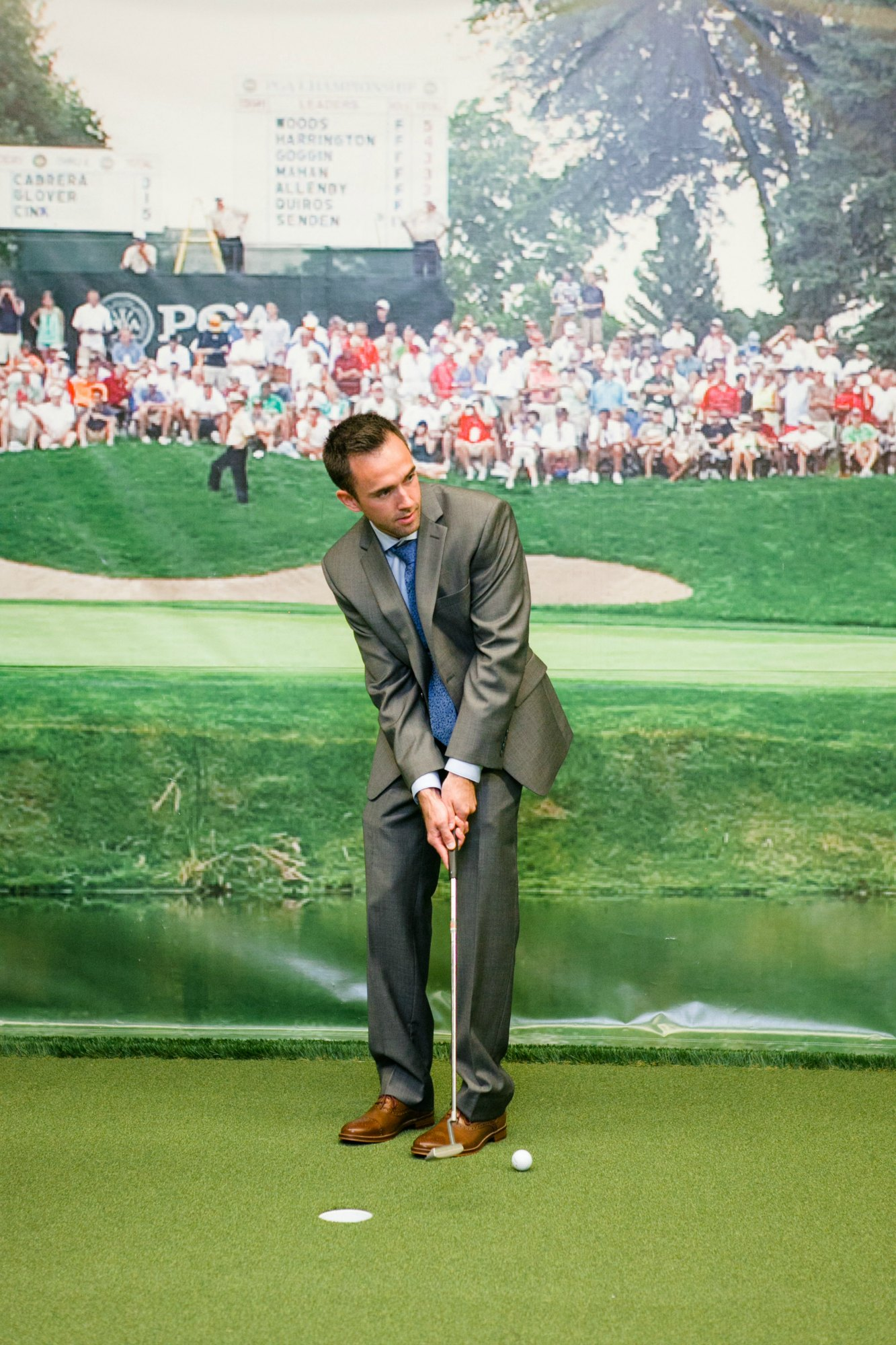 Groom in Learning Center before his wedding reception at Hazeltine National Golf Club