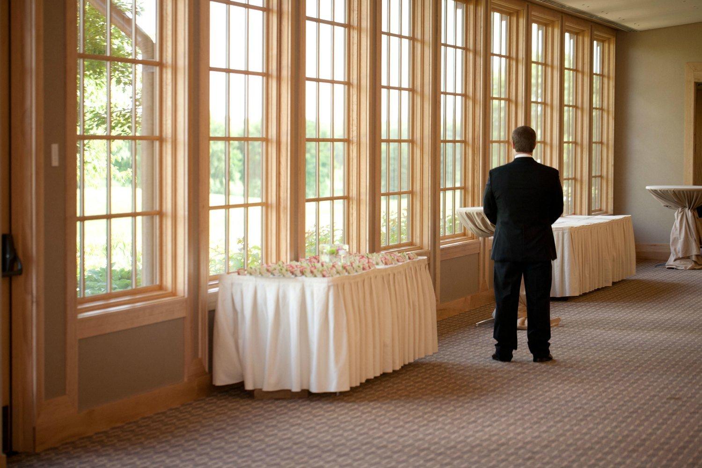 Groom awaiting the bride before the wedding reception at Hazeltine National Golf Club