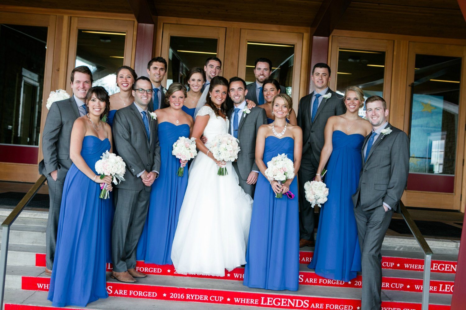 Wedding party at the front entrance of Hazeltine National Golf Club