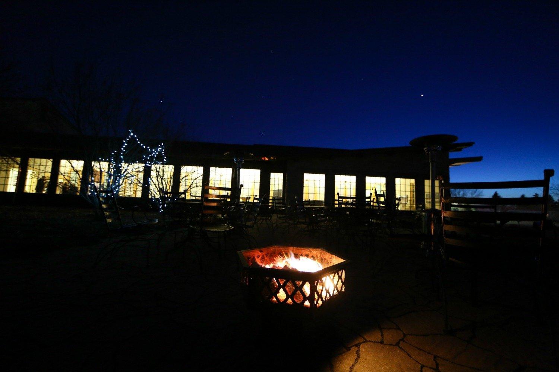 Bonfire on the patio during a wedding reception at Hazeltine National Golf Club