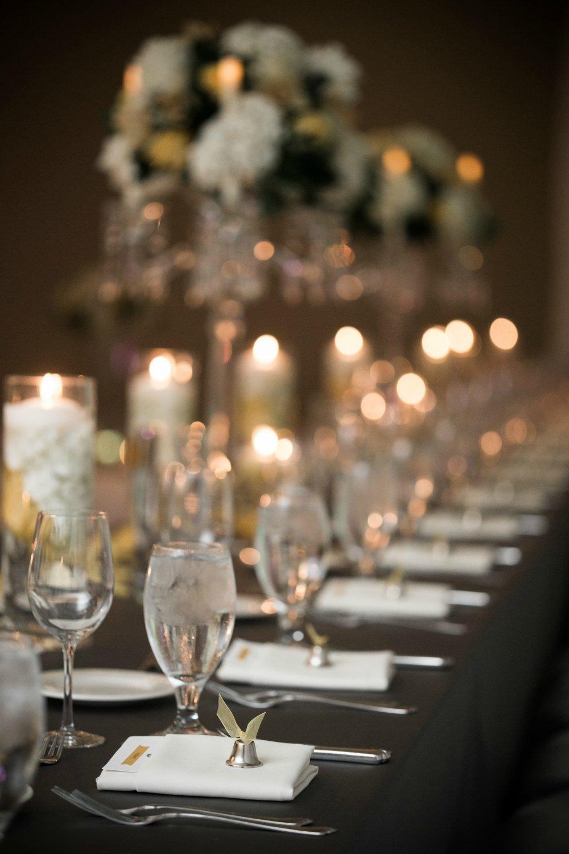 Elegant head table set for a winter wedding reception at Hazeltine National Golf Club