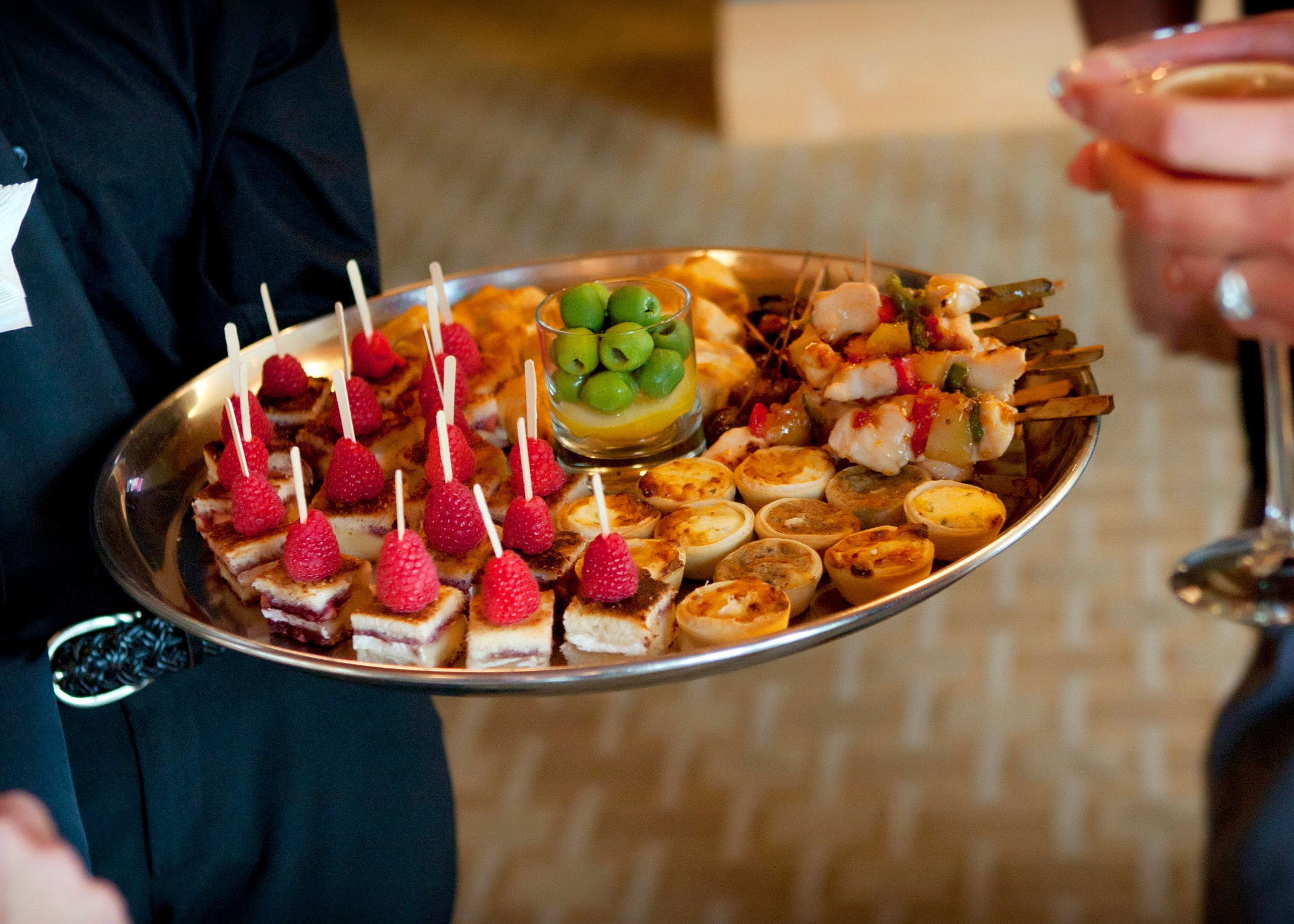 Golfers enjoy a variety of appetizers after a networking event at Hazeltine National Golf Club