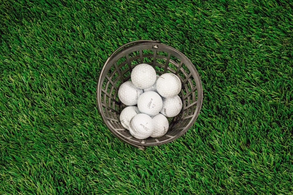 Bucket of balls ready to be hit during a golf networking event at Hazeltine National Golf Club
